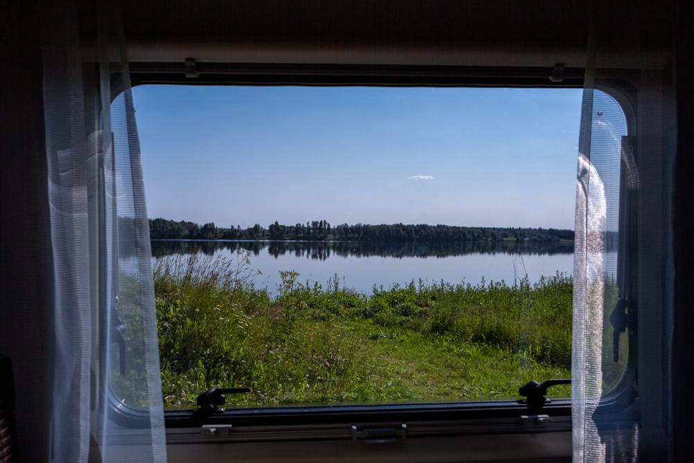 windows of RV overlooking a field